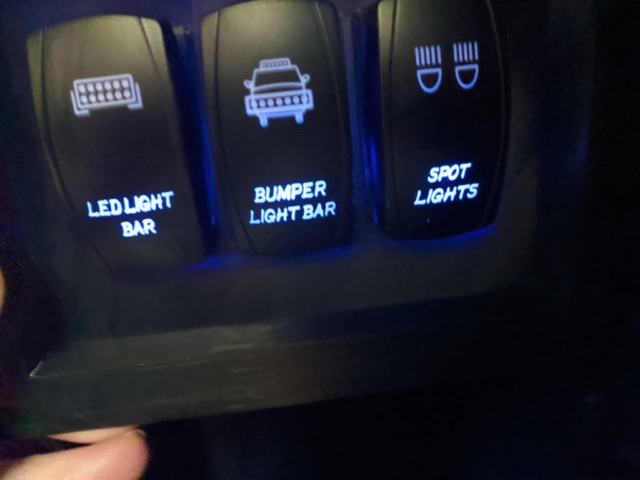 Switches light up on the bottom with key on, then light up on top when activated